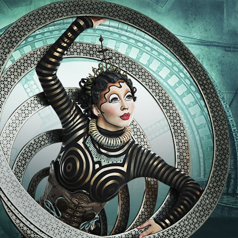 Klara using her hoop skirt to receive alpha waves in the show KURIOS